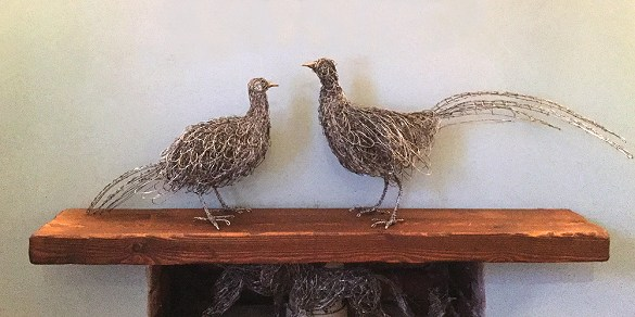 A pair of Pheasants in stainless steel wire